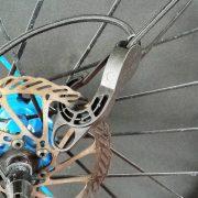 Sujetar panel de cargas a bici